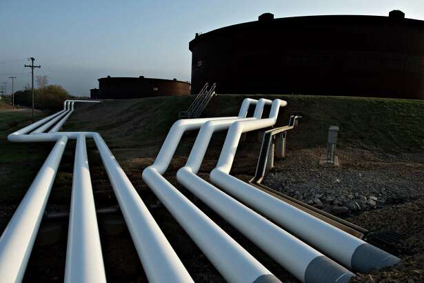 Pipelines run toward oil storage tanks at the Enbridge terminal in Cushing, Okla. In trading Wednesday, the price for U.S. benchmark crude rose $2.56 to $47.15 per barrel on the New York Mercantile Exchange. Brent rose $2 to $49.75.