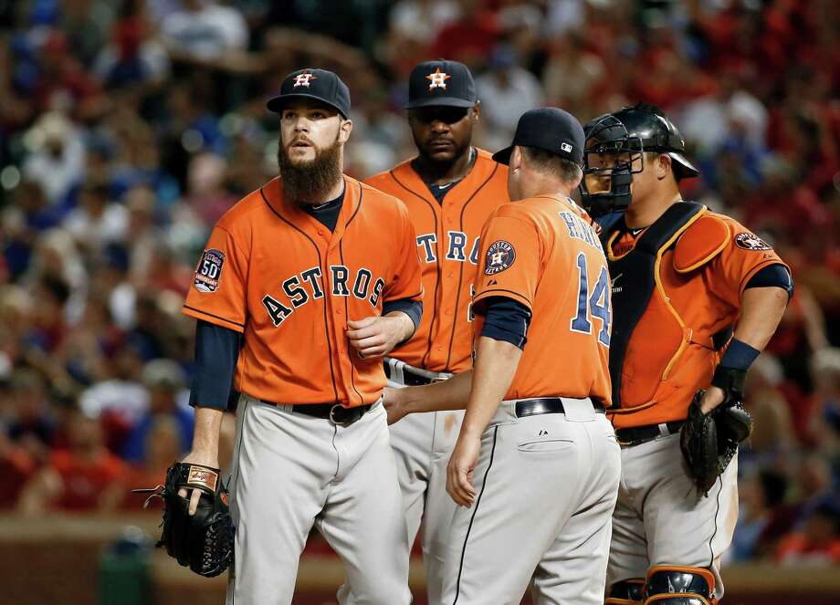 What a relief it must have been for Dallas Keuchel, left, to be taken out of the game by manager A.J. Hinch after allowing nine runs in 42⁄3 innings. Photo: Tony Gutierrez, STF / AP