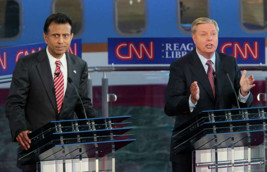 Republican presidential candidates Bobby Jindal, left, and Lyndsey Graham on the debate stage at the Reagan Library in Simi Valley, Calif., on Wednesday, Sept. 16, 2015. (Robert Gauthier/Los Angeles Times/TNS) Photo: Robert Gauthier, MBR / McClatchy-Tribune News Service / Los Angeles Times