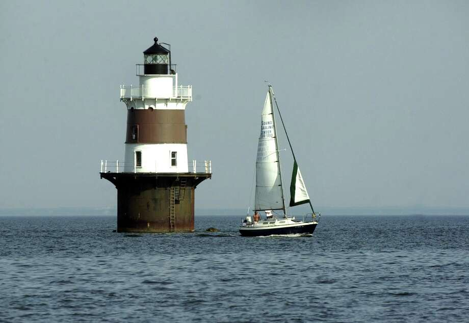 A sailboat passes by Pecks Ledge Lighthouse, which marks, the Eastern approach to the Norwalk Harbor and warns sailors of a shallow reef. Chris Preovolos/Staff Photo Photo: File Photo