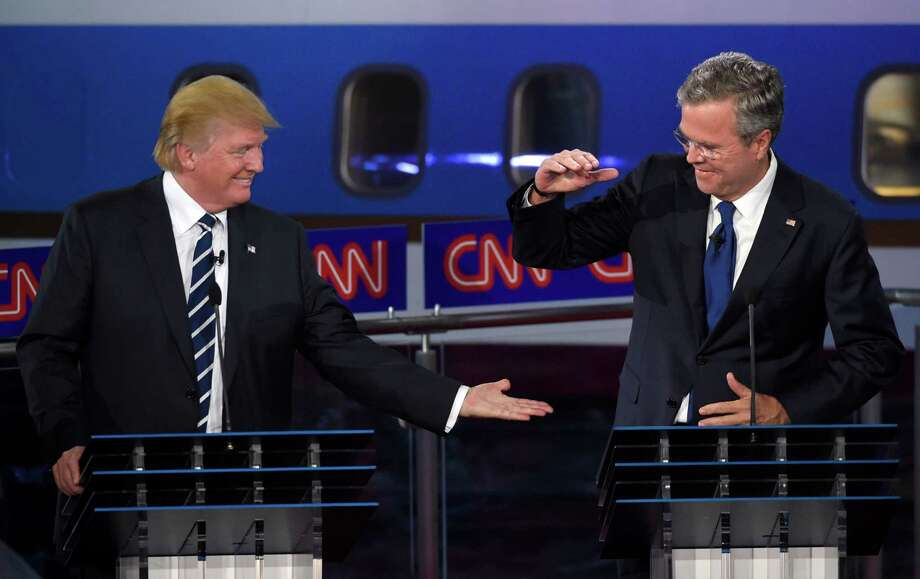 Republican presidential candidate, businessman Donald Trump, left, and Jeb Bush slap hands near the finish of the CNN Republican presidential debate at the Ronald Reagan Presidential Library and Museum on Wednesday, Sept. 16, 2015, in Simi Valley, Calif. (AP Photo/Mark J. Terrill) ORG XMIT: CATS191 Photo: Mark J. Terrill / AP
