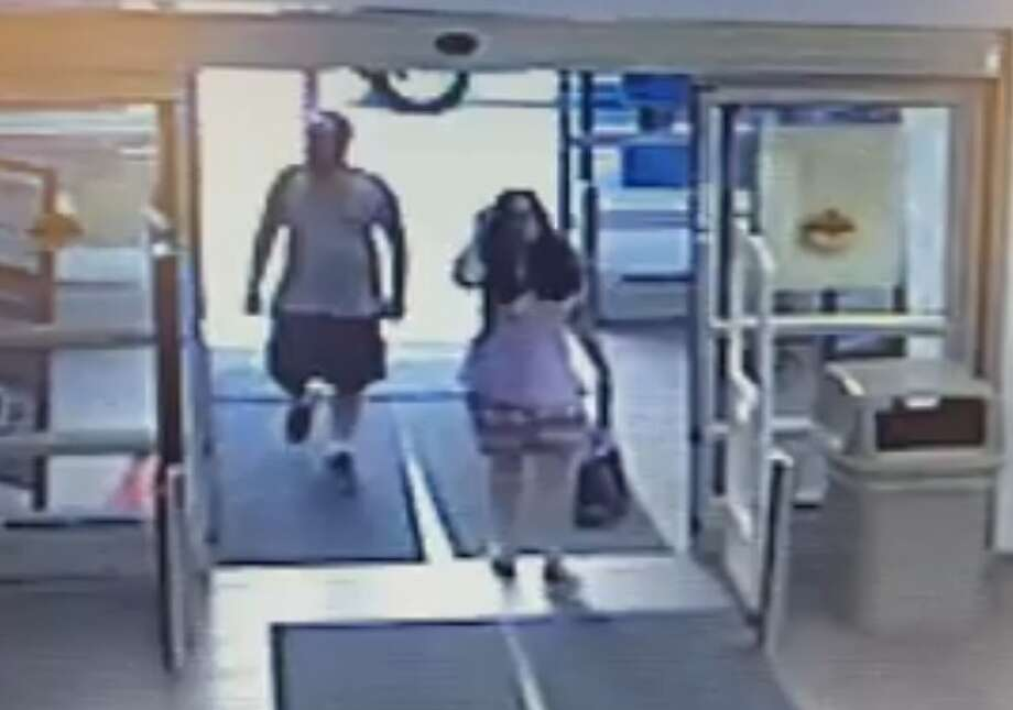 The Rotterdam Police Department identified the couple suspected of stealing a purse -- shown here entering the Rotterdam Walmart Sept. 13, 2015, at 5 p.m. They were identified as Nelson Guillet and Janene LaRusso, both of Rotterdam. (Photo from surveillance camera)