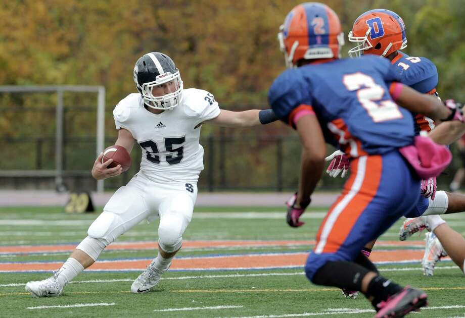 Photos from the Staples and Danbury High School boys football game on Saturday, October, 18, 2014, in Danbury, Conn. Staples #25 Ethan Burger Photo: H John Voorhees III / H John Voorhees III / The News-Times Staff Photographer