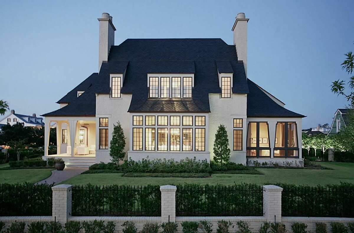 No. 2: 34 East Shore Drive | Sold between: $4.4 and $5 million Originally created as a designer showcase home, the new construction comes courtesy of award-winning architect Bobby McAlpine. It spans 8,400 square feet of Cape Cod-style architecture in the center of The Woodlands.