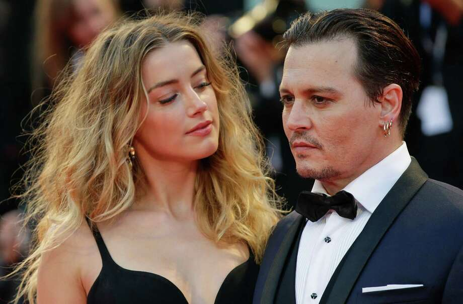 "Amber Heard, left, and Johnny Depp are shown at the premiere of the film ""Black Mass"" during the Venice Film Festival in Venice, Italy, in 2015.  Photo: Andrew Medichini, STF / Associated Press / AP"