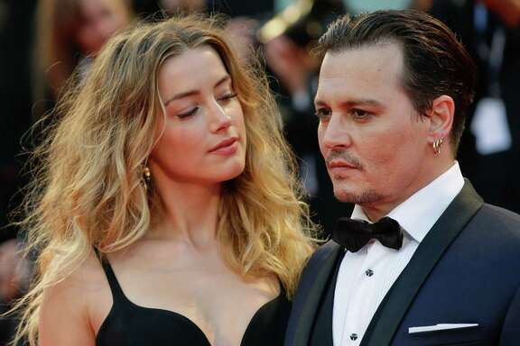 Amber Heard, left, and Johnny Depp pose for photographers upon arrival at the premiere of the film Black Mass during the 72nd edition of the Venice Film Festival in Venice, Italy, Friday, Sept. 4, 2015. The 72nd edition of the festival runs until Sept. 12.  (AP Photo/Andrew Medichini)