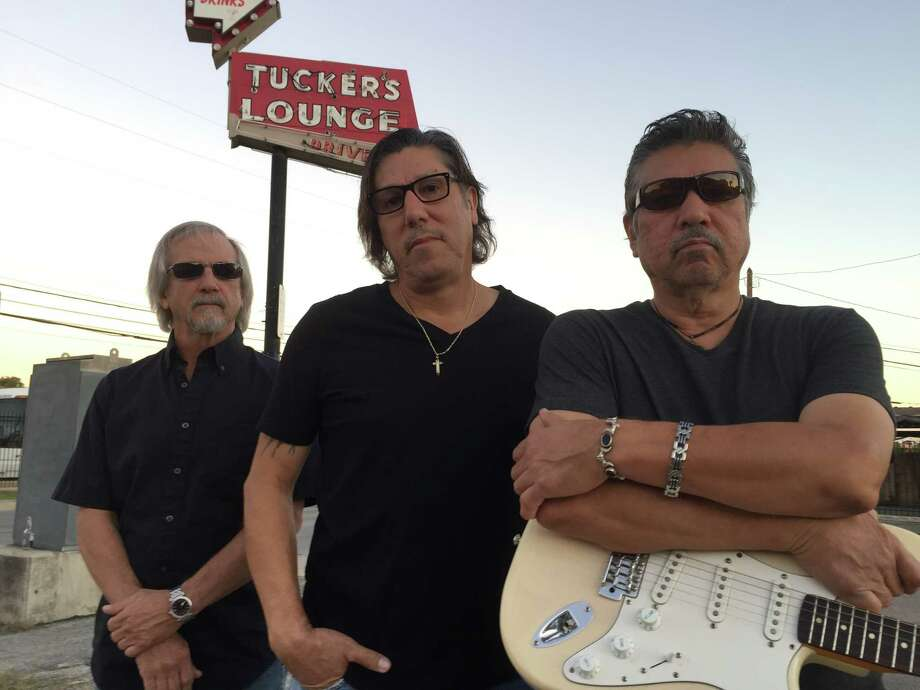 Johnny Moore (left), Roy Perez (center) and Henry Perez are the Rhythm Kings. Henry Perez is known as River City Slim. Photo: Hector Saldaña / San Antonio Express-News