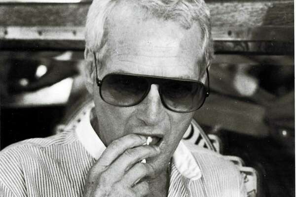 Aug. 1, 1984 - Paul Newman eating his own popcorn during a Victorian-style fundraising picnic at the Wheeler House in Westport. Glenn Osmundsn, Staff file photo.