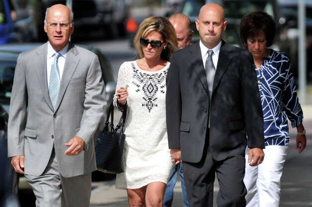 Troy Police Officer Brian Gross, right, walks with attorney Steve Coffey, left, to face evidence tampering charges on Wednesday, July 30, 2014, at City Court in Troy, N.Y. (Cindy Schultz / Times Union archive) Photo: Cindy Schultz