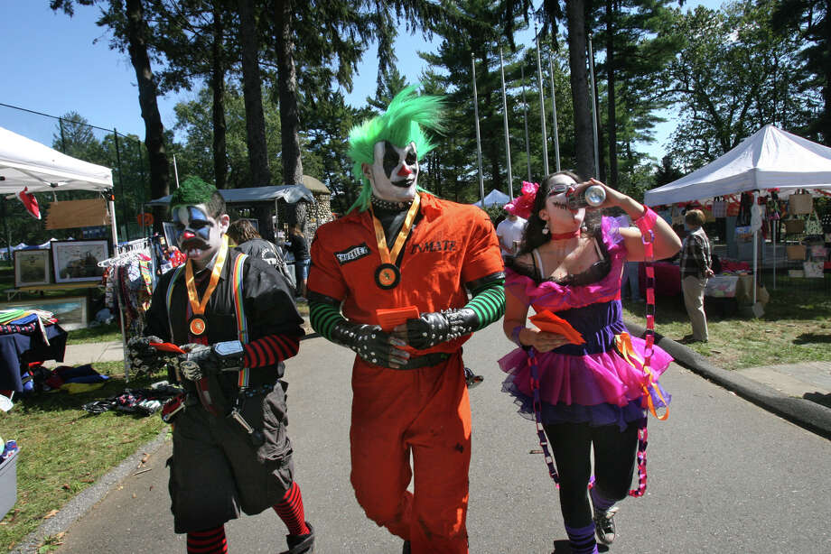 "Volunteer actors, from left, Robert Rodriquez, Curtis Edwards, and Margarita Nieves,  hand out ads at the Seymour Pumpkin Festival at French Memorial Park on Sunday, September 18, 2011 for a ""Haunted Isle"" to benefit The Shore Line Trolley Museum . The Haunted Isle is open on Friday and Saturday nights in October. Photo: B.K. Angeletti / B.K. Angeletti / Connecticut Post"