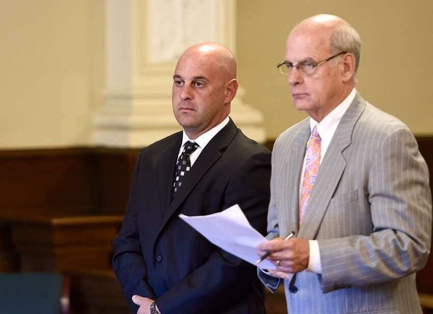 Brian Gross, left, and his lawyer, Stephen Coffey, stand in court where Reneselaer County Judge Andrew Ceresia sentenced Gross, an ex-Troy cop, to probation for tipping off a drug dealer. (Skip Dickstein / Times Union)