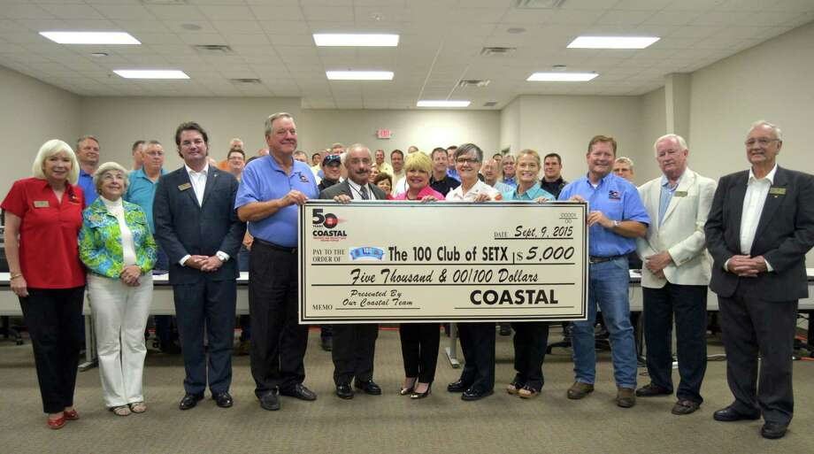 "Team members of all eight Coastal Welding Supply locations provide a back drop for a recent $5,000 donation to the 100 Club of Southeast Texas. (L-R) 100 Club Board Members Cindy Yohe Lindsay, also with Coastal, Marie Richard and Vice President Warren Claybar. Holding check (L to R) are Coastal Vice President Tom Johnson, Beaumont Police Chief Jimmy Singletary, Beaumont Mayor Becky Ames, Beaumont Fire and Rescue Chief Anne Huff, Barbara Mazoch Nelson, Coastal Corporate Secretary, Coastal President J.C. ""Chuck"" Mazoch , 100 Club President Zack Shelton and board member Karl Duerr, Jr.    Photo: Coastal Welding"