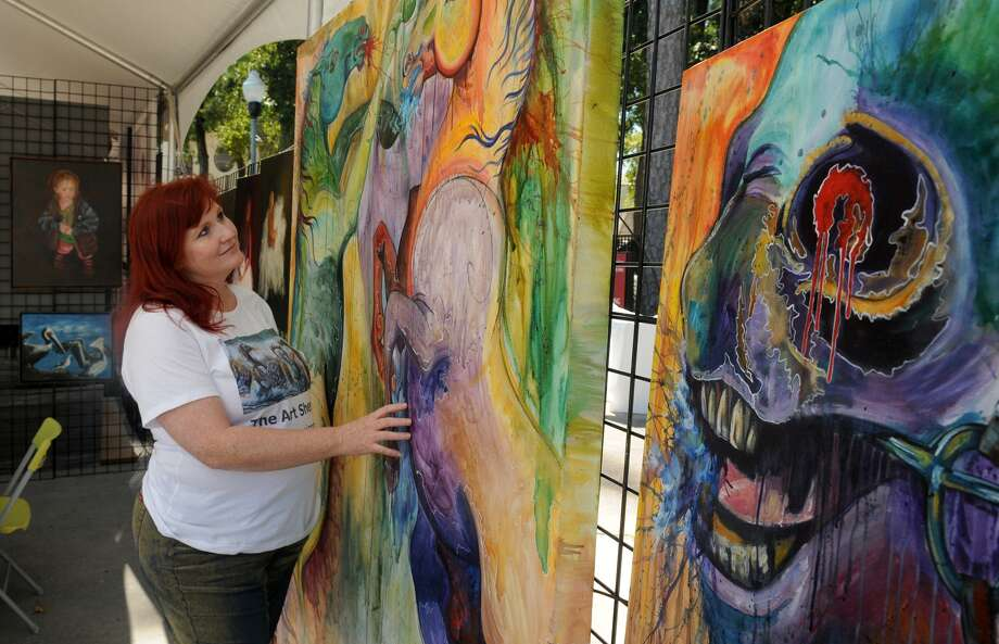 Cinnamon Cooney, of Humble, shows off her work during CreekFest Art & Soles Festival of Arts organized by the Houston Northwest Chamber of Commerce. Photo: Jerry Baker, Freelance