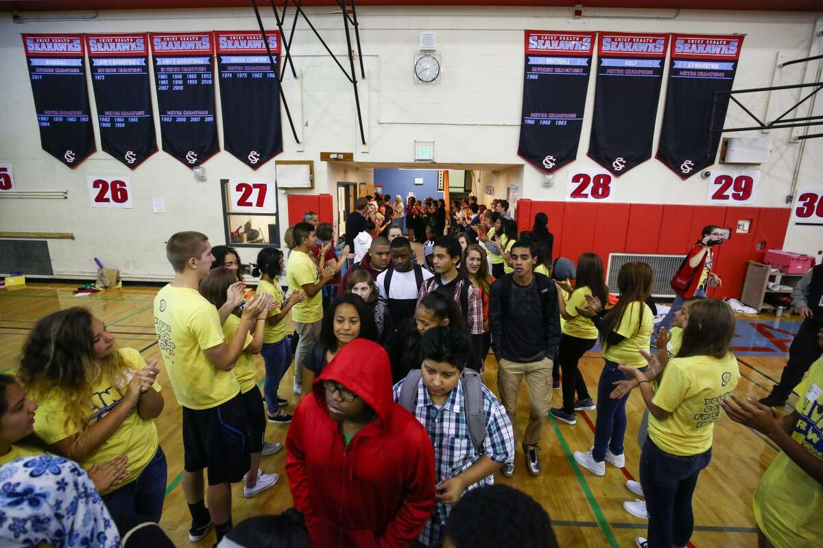 Incoming freshmen are welcomed at Chief Sealth International High School on Thursday, Sept. 17, 2015, the first day of classes in the Seattle school district. A teachers strike delayed the opening of school by a week.