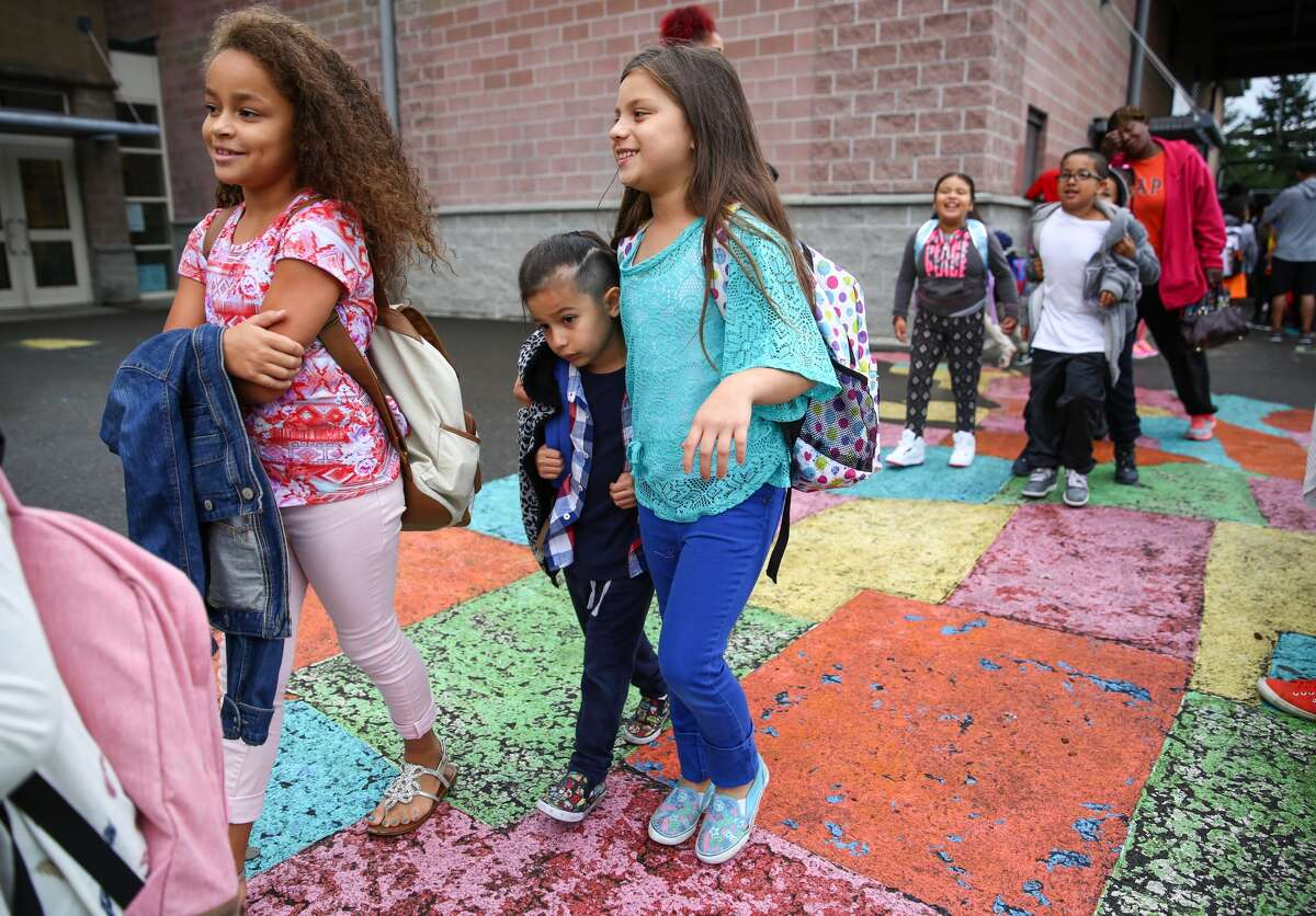 Students start the first day of classes at Concord International Elementary School on Thursday, Sept. 17, 2015. Classes in the Seattle district started a week late after a teachers strike.