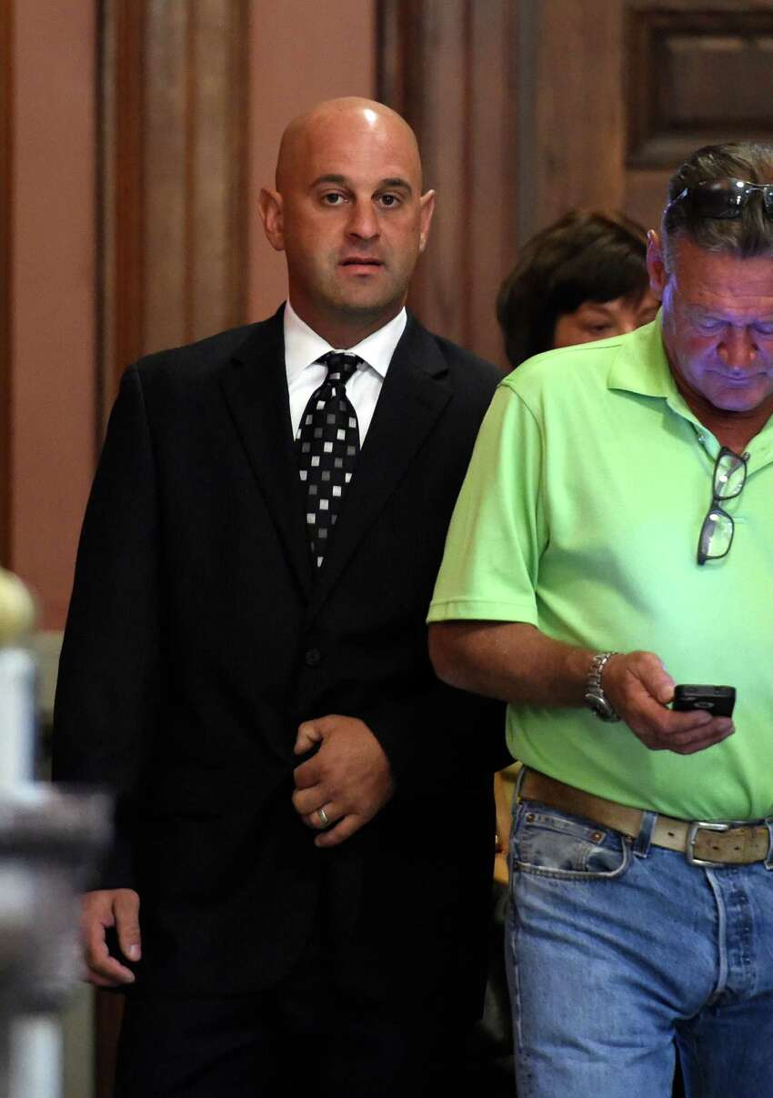 Former Troy Police officer Brian Gross arrives for his sentencing in Rensselaer County Court Thursday morning Sept. 17, 2015 in Troy, N.Y. Brian Gross, 33, of North Greenbush, who was assigned to the Community Narcotics Enforcement Team, was sentenced by Judge Andrew Ceresia. In June, Gross admitted his guilt to Ceresia during a plea. (Skip Dickstein/Times Union)