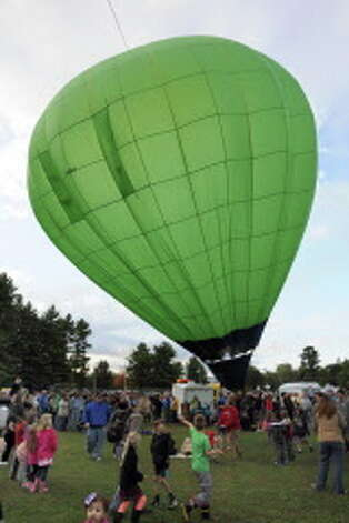 The Limelight balloon rises during the 42nd annual Adirondack Balloon Festival on Thursday, Sept. 18, 2014, at Crandall Park in Glens Falls, N.Y. (Cindy Schultz / Times Union) Photo: Cindy Schultz / 00028662A