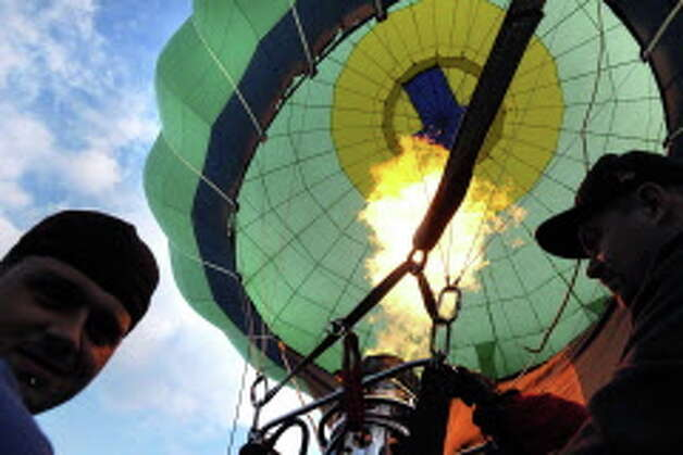 A blast of propane enters the Limelight balloon during the 42nd annual Adirondack Balloon Festival on Thursday, Sept. 18, 2014, at Crandall Park in Glens Falls, N.Y. (Cindy Schultz / Times Union) Photo: Cindy Schultz / 00028662A