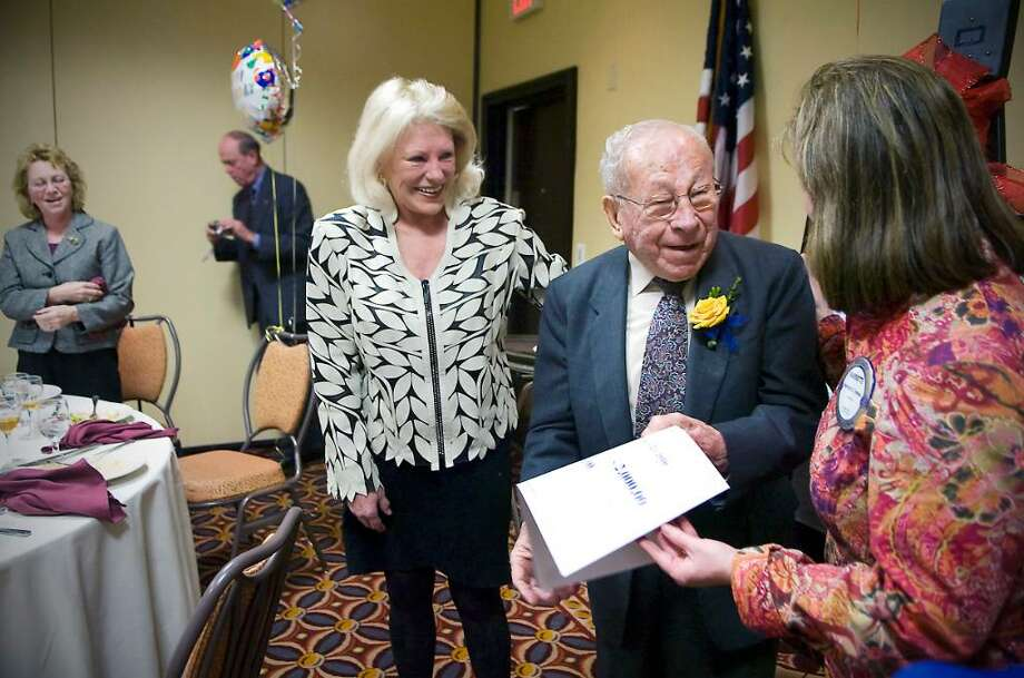 Dom Telesco is honored for his 98th birthday at a celebration with the Stamford Rotary Club at the Holiday Inn in Stamford, Conn. on Tuesday, March 23, 2010.  He is congratulated by Dori Dillon, President of the Stamford Rotary Club,  and Harriette Trevino, Chairman of the Fellowship Committee. Photo: Kathleen O'Rourke / Stamford Advocate