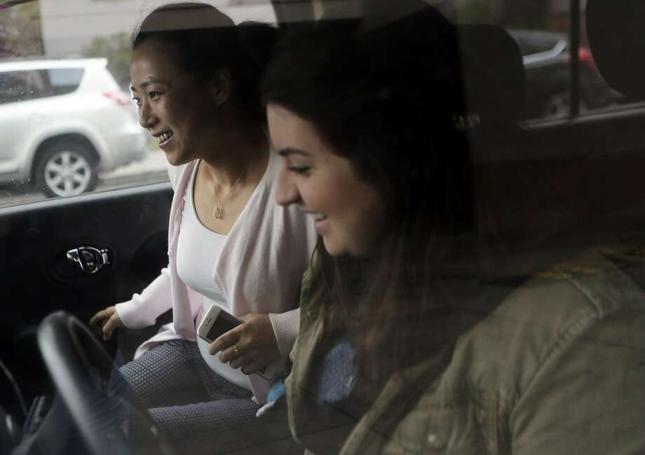 Donna Scarola, driver, picks up Betty Cao in Oakland, Ca. before driving to their jobs in Pleasanton, Ca. on Wednesday, September 16, 2015. This is the second time the pair has carpooled together to work. They met via a new app called Scoop. Photo: Dorothy Edwards, The Chronicle