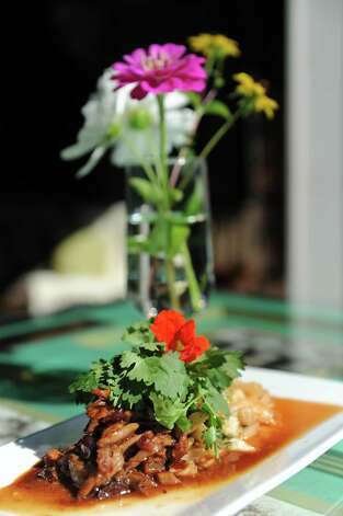 Pork belly kimchi at Mouzon House on Friday Sept. 11, 2015 in Saratoga Springs, N.Y.  (Michael P. Farrell/Times Union) Photo: Michael P. Farrell / 00033327A