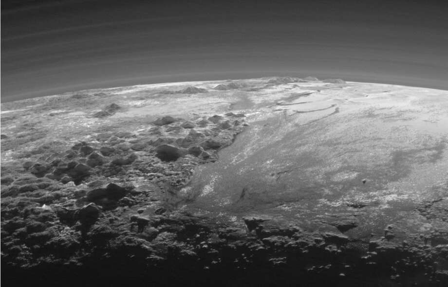 Closer Look: Majestic Mountains and Frozen Plains: Just 15 minutes after its closest approach to Pluto on July 14, 2015, NASA's New Horizons spacecraft looked back toward the sun and captured this near-sunset view of the rugged, icy mountains and flat ice plains extending to Pluto's horizon.  Photo: NASA/JHUAPL/SwRI
