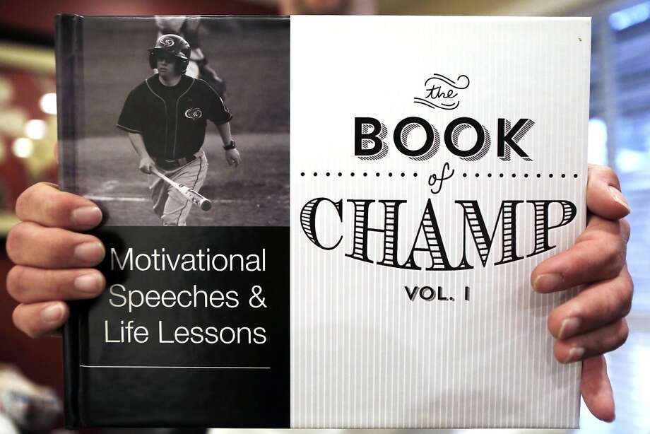 "Left: Champ, who has Down syndrome, holds a book that contains a collection of motivational speeches that he gave to the UOP team. He recently accom panied brother Joc, the Dodgers' center fielder, to a banquet, where Champ spoke on behalf of his ""baby brother."" Photo: Dorothy Edwards, The Chronicle"
