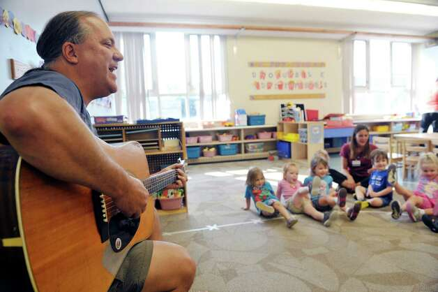 Musician Andy Morse leads children in a song at Albany Med Kids Child Care on Wednesday, Sept. 9, 2015, in Albany, N.Y.   (Paul Buckowski / Times Union) Photo: PAUL BUCKOWSKI / 00033272A