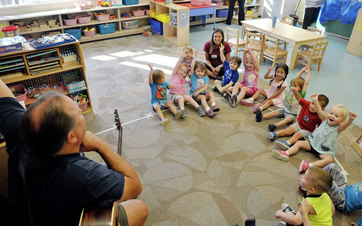 Musician Andy Morse leads children in a song at Albany Med Kids Child Care on Wednesday, Sept. 9, 2015, in Albany, N.Y. (Paul Buckowski / Times Union)