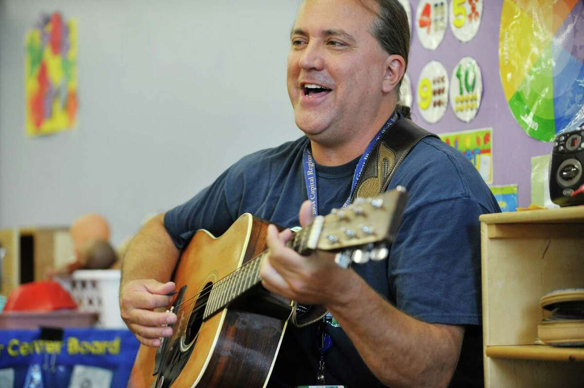 Musician Andy Morse sings to children at Albany Med Kids Child Care on Wednesday, Sept. 9, 2015, in Albany, N.Y. (Paul Buckowski / Times Union)