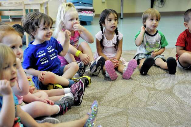 Children at Albany Med Kids Child Care  sing along with musician Andy Morse on Wednesday, Sept. 9, 2015, in Albany, N.Y.   (Paul Buckowski / Times Union) Photo: PAUL BUCKOWSKI / 00033272A