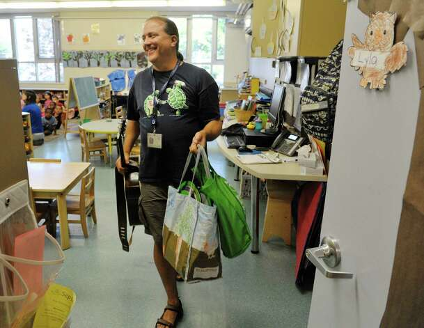 Musician Andy Morse leaves one classroom on his way to another class at Albany Med Kids Child Care on Wednesday, Sept. 9, 2015, in Albany, N.Y.   (Paul Buckowski / Times Union) Photo: PAUL BUCKOWSKI / 00033272A