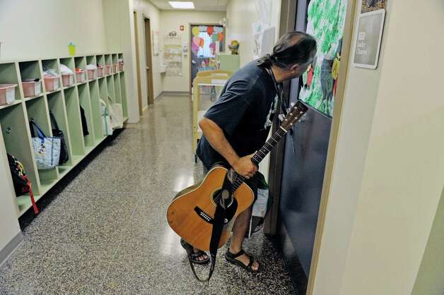 Musician Andy Morse makes his way into a classroom at Albany Med Kids Child Care on Wednesday, Sept. 9, 2015, in Albany, N.Y.   (Paul Buckowski / Times Union) Photo: PAUL BUCKOWSKI / 00033272A