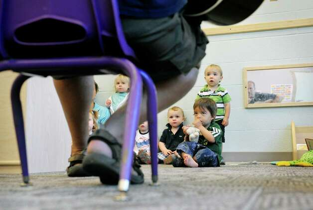Musician Andy Morse faces a tough crowd as he sings to children who have never met him before at Albany Med Kids Child Care on Wednesday, Sept. 9, 2015, in Albany, N.Y.   (Paul Buckowski / Times Union) Photo: PAUL BUCKOWSKI / 00033272A