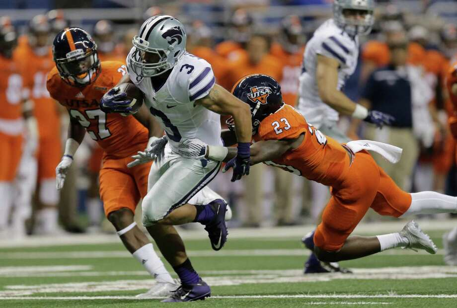 Kansas State's Dalvin Warmack (3) is pulled down by UTSA's Darryl Godfrey (23) during the second half on Sept. 12, 2015, in San Antonio. UTSA's Joseph Barsalou (27) assists on the play. Kansas State won 30-3. Photo: Eric Gay /Associated Press / AP