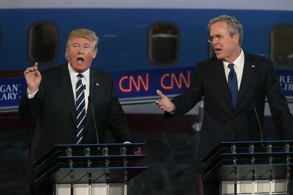 Republican presidential candidates Donald Trump, left, and Jeb Bush spar early in the GOP debate at the Reagan Library in Simi Valley, Calif., on Wednesday, Sept. 16, 2015.