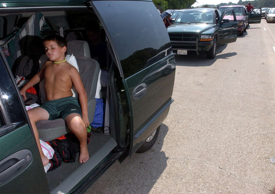 Eight year-old Caleb Barton tried to stay cool in his mother's minivan as he and his family fleed Hurricane Rita a few feet at a time along northbound U.S. Highway 96 near Silsbee. Photo: Beaumont Enterprise / THE BEAUMONT ENTERPRISE