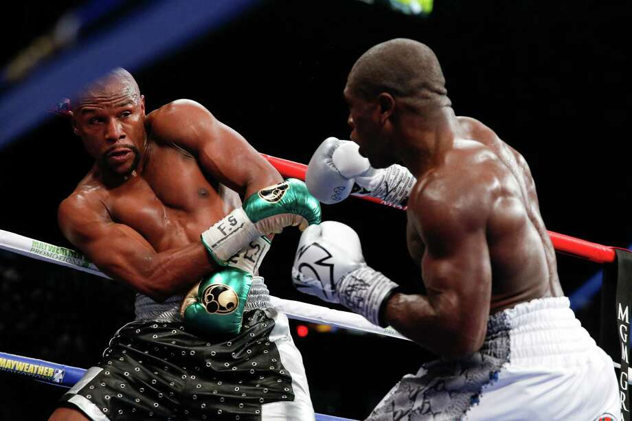 Floyd Mayweather Jr. and Andre Berto during their welterweight title fight Saturday, Sept. 12, 2015, in Las Vegas. Photo: John Locher /Associated Press / AP