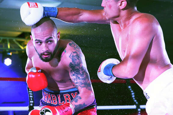 James Leija Jr. ducks a punch during his pro boxing debut against Cesar Martinez at the San Antonio Event Center on Aug. 8, 2015.