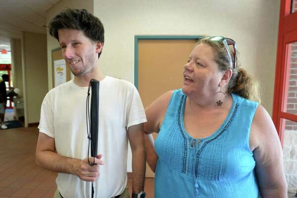 Charles Shields, left, evacuated Beaumont with his father to Pineland where they were stuck with little gas or food. Laurie Bray is also pictured. Photo taken Tuesday, July 14, 2015 Guiseppe Barranco/The Enterprise