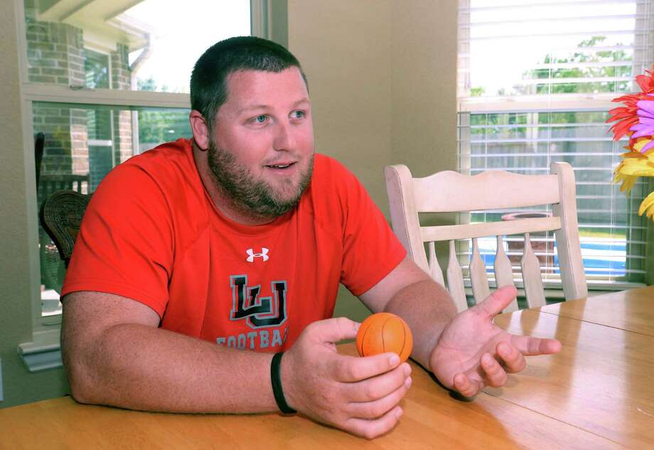 """As a kid, it wasn't that crazy. It was fun.""A junior and football player at Orangefield High School during Hurricane Rita, Brett Ramsey said he worked to clear debris from the high school to help the football program return to a abnormal schedule of games for the season.   Photo: Guiseppe Barranco, Beaumont Enterprise"