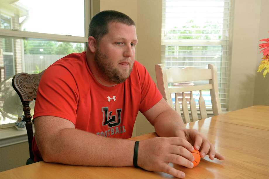 A junior and football player at Orangefield High School during Hurricane Rita, Brett Ramsey said he worked to clear debris from the high school to help the football program return to a abnormal schedule of games for the season. Photo: Guiseppe Barranco, Photo Editor