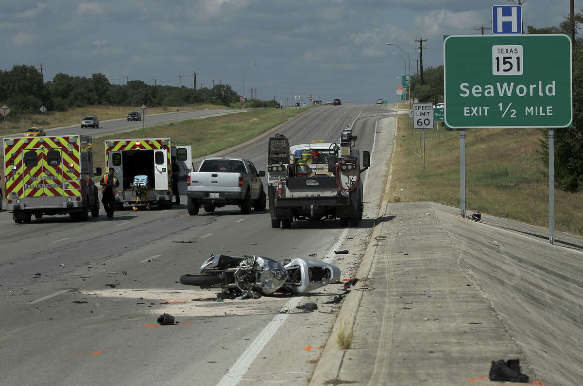 San Antonio police and fire personnel work Thursday September 17, 2015 at the scene of an accident involving a motorcycle and a pickup truck at about 2:15 p.m. at West Loop 1604 South and Wiseman Road. Patrolman Ricardo Perez said the 22-year-old male driver of a motorcycle collided with a grey Ford pickup truck that was making a turnaround on Loop 1604. After colliding, Perez said the driver of the motorcycle flew off his bike and hit the Sea World 151 sign and both of his legs were severed off. A police officer on his way to work was the first on the scene and applied a tourniquet. The injured man was transported from the scene by an Air Life helicopter and is in critical condition.