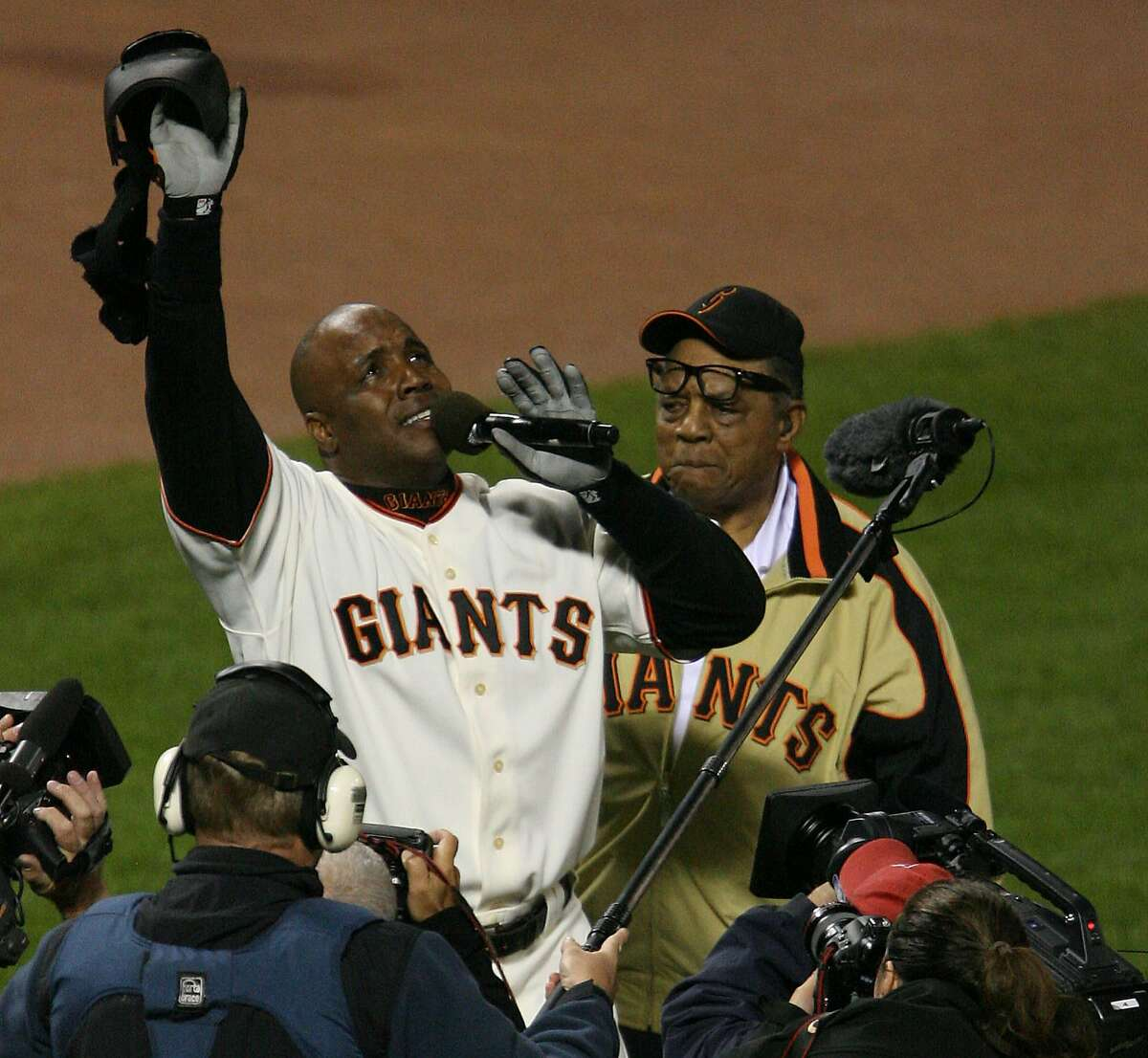After hitting his 756th home run, Barry Bonds and Willie Mays appear to be near tears. Celebration of Barry Bonds's 756th home run that breaks the all-time career home run record.