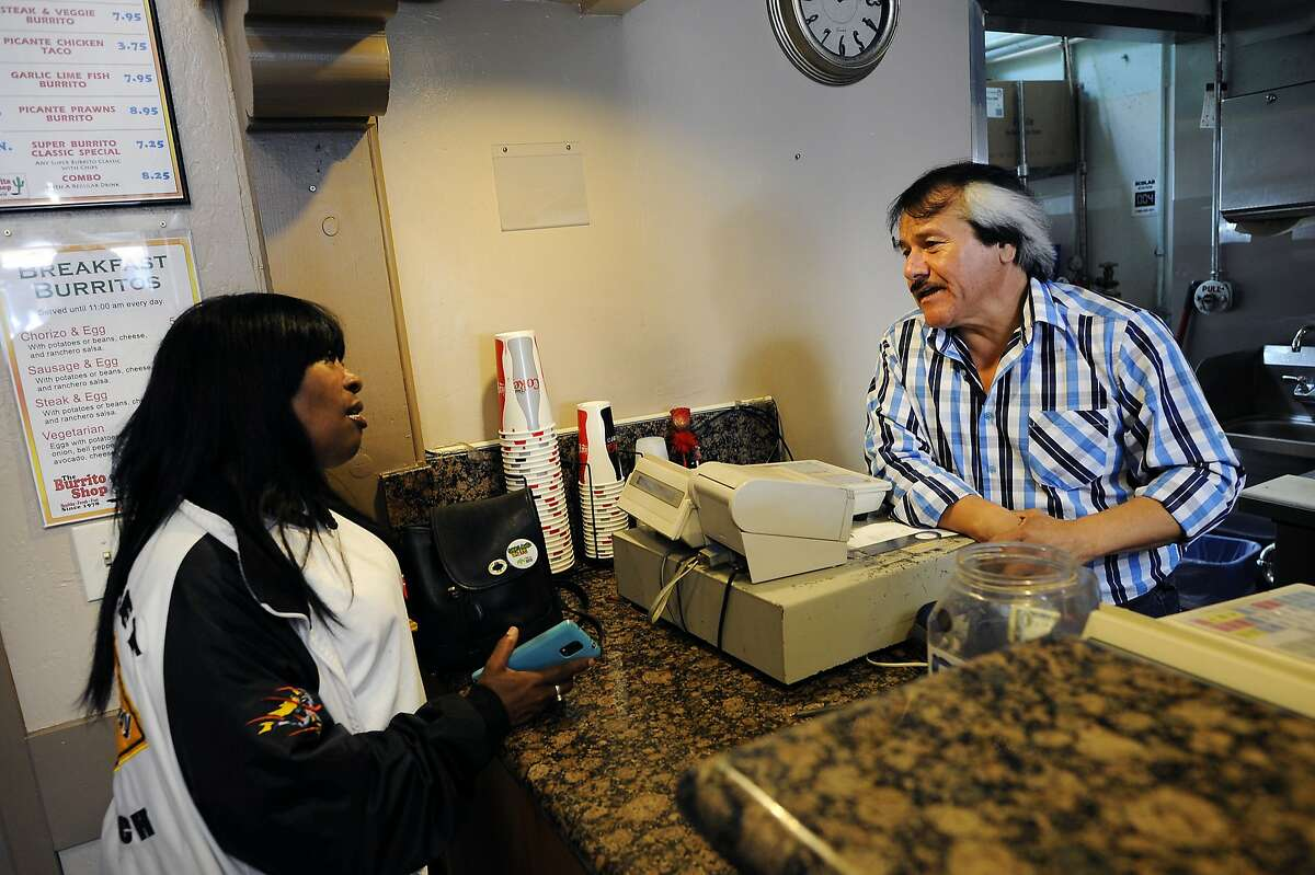 Longtime customer Natasha Cox, left, expresses her dismay to owner Jose Ortiz, that The Burrito Shop will be closing soon on Lakeshore Blvd. in Oakland, CA Thursday, September 17, 2015.