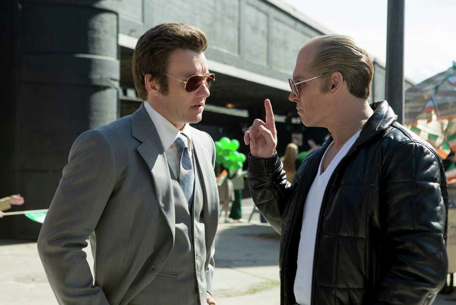 "In this image released by Warner Bros. Entertainment, Joel Edgerton portrays John Connolly, left, and Johnny Depp portrays Whitey Bulger in the Boston-set film, ""Black Mass."" (Claire Folger/Warner Bros. Entertainment via AP) ORG XMIT: NYET331 Photo: Claire Folger / Warner Bros. Entertainment"