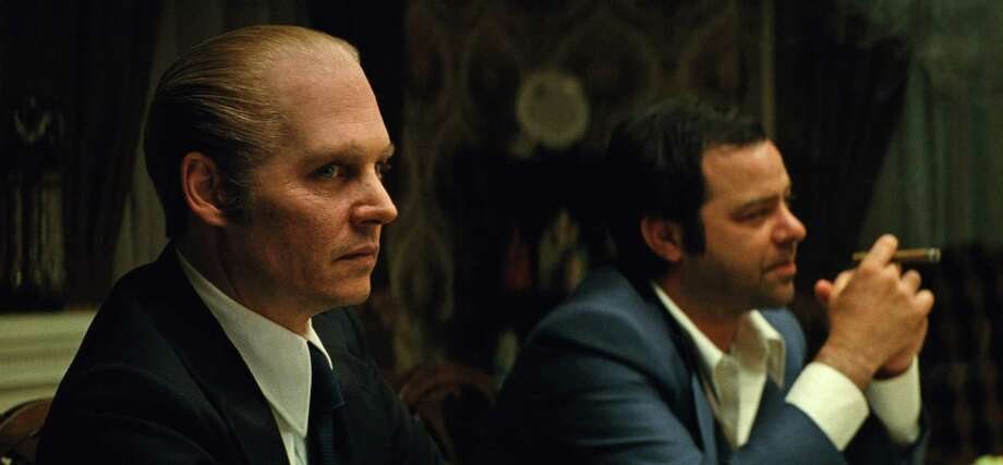 "In this image released by Warner Bros. Entertainment, Johnny Depp, left, and Rory Cochrane appear in a scene from, ""Black Mass."" (Claire Folger/Warner Bros. Entertainment via AP) ORG XMIT: NYET338 Photo: Claire Folger / Warner Bros. Entertainment"