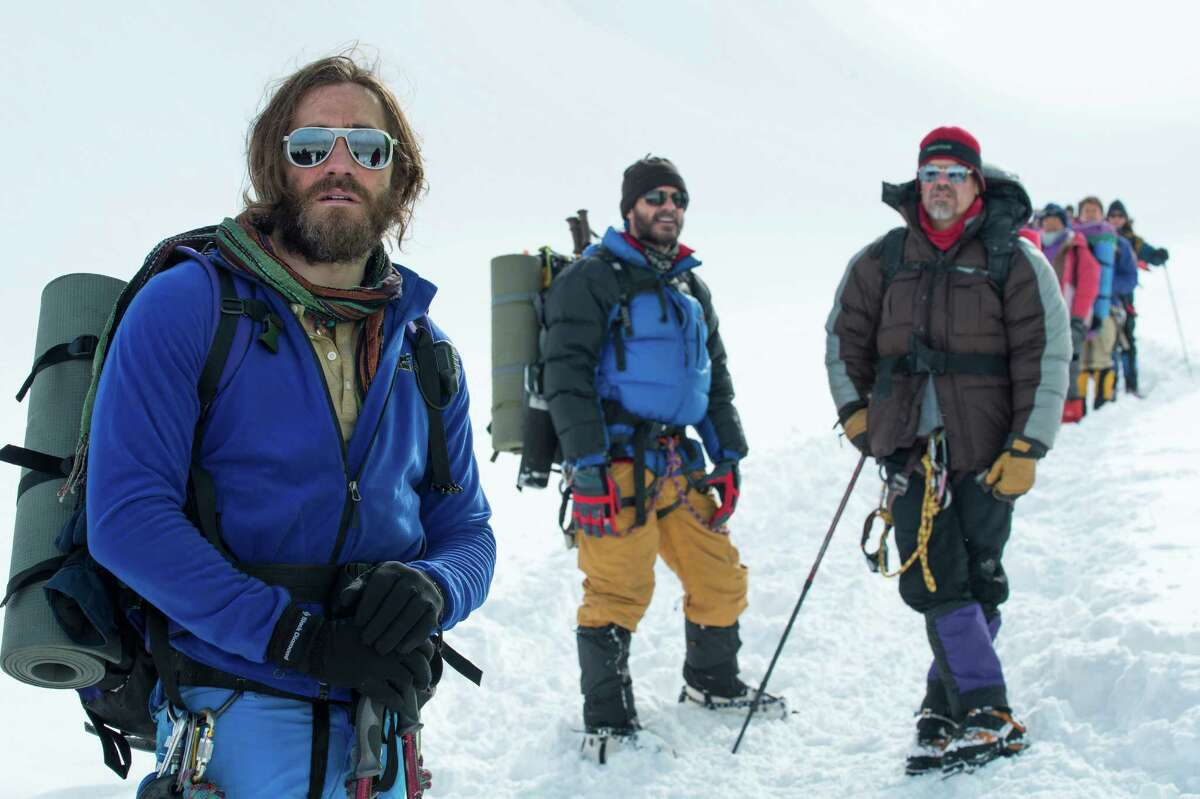 This photo provided by Universal Pictures shows, Jake Gyllenhaal, from left, as Scott Fischer, Michael Kelly as Jon Krakauer, and Josh Brolin as Beck Weathers, in the film ?