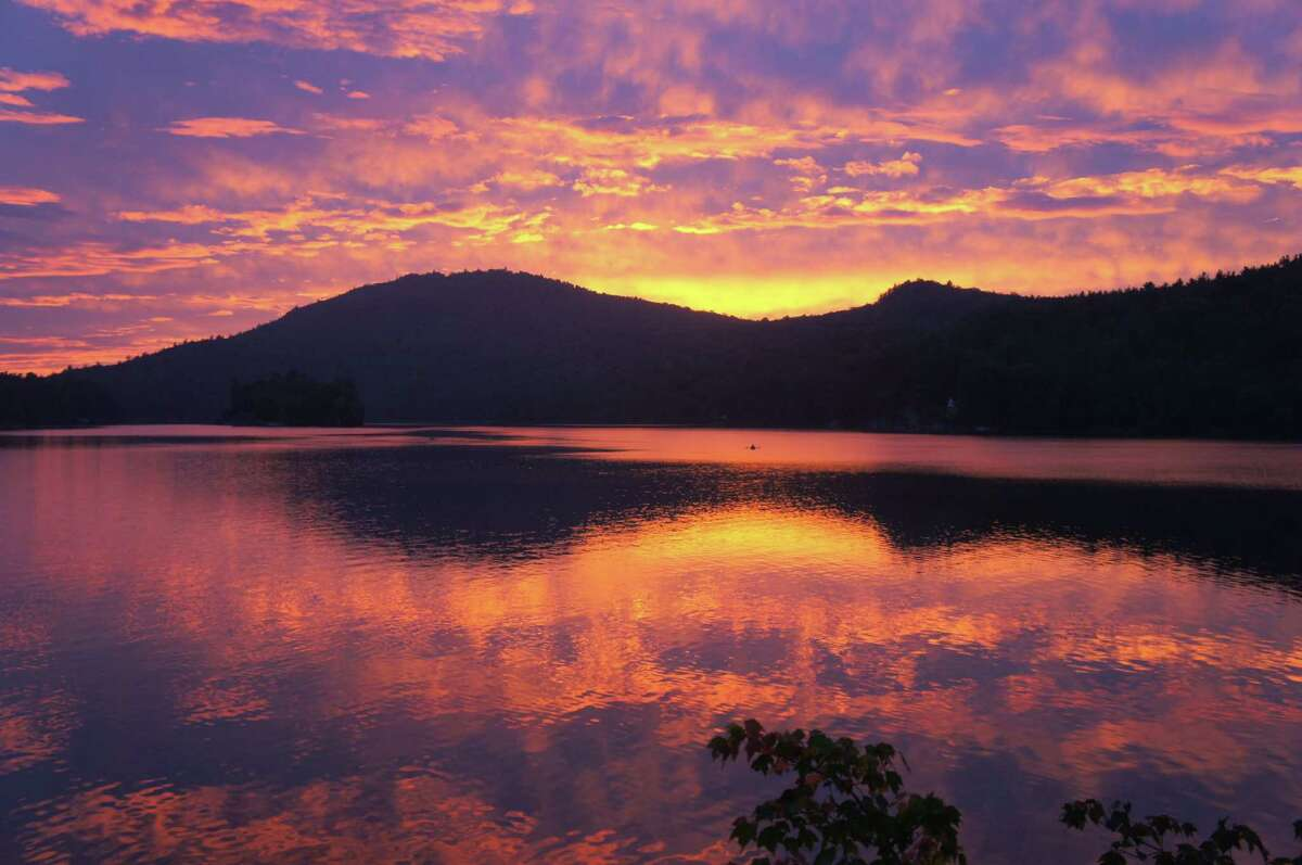 The sun sets over Eagle Lake near Ticonderoga in the Adirondacks. (Herb Terns / Times Union)