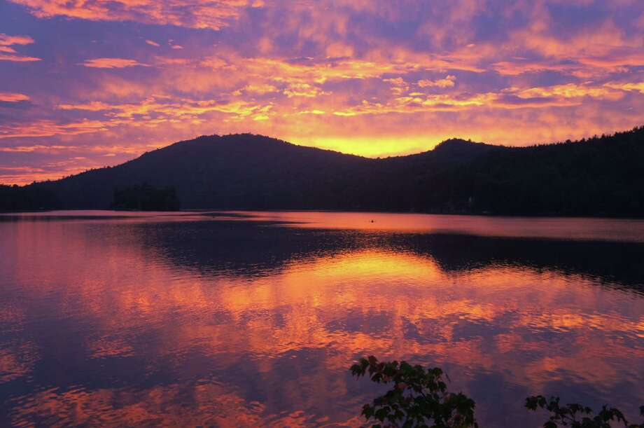 The sun sets over Eagle Lake near Ticonderoga in the Adirondacks. (Herb Terns / Times Union) Photo: Picasa